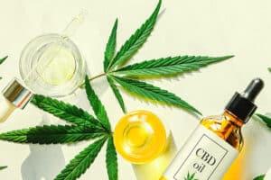 CBD oil, marijuana leaves and CBD tinctures, CBD beauty products