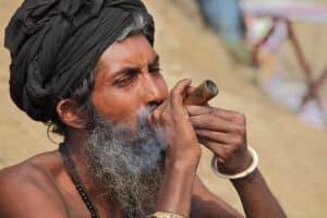 Man in India smoking marijuana with chillum