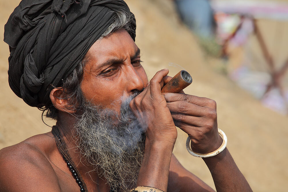 Man in India smoking marijuana with chillum