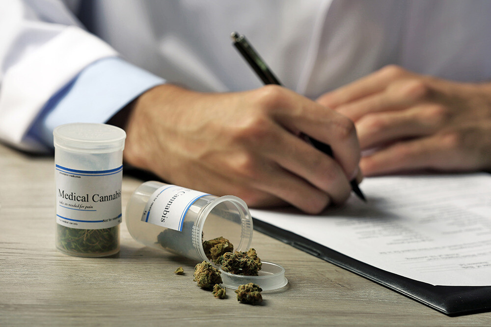 Doctor writing prescription for medical marijuana