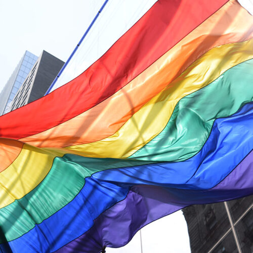Pride Flag waving in Downtown area