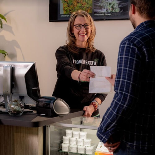 From The Earth cannabis dispensary in Hanover, MI staff member with customer